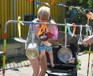 Playing the saucepans in the sunshine